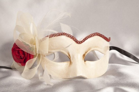 red masquerade mask with fascinator