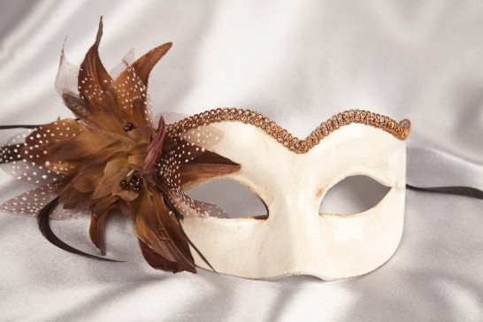 brown masquerade mask with fascinator