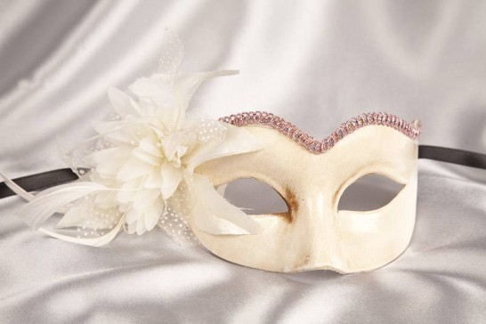 pink masquerade mask with fascinator