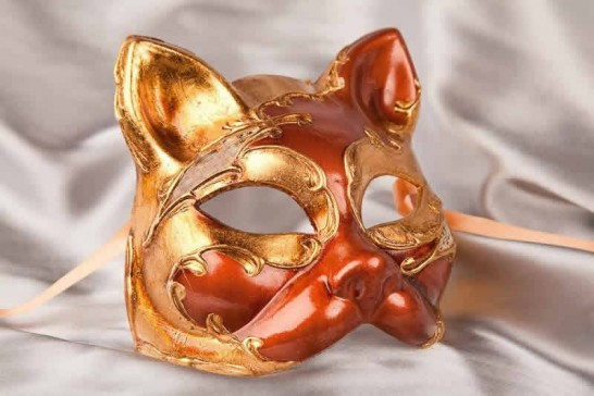 enetian cat mask with musical notes and gold leaf in rust brown