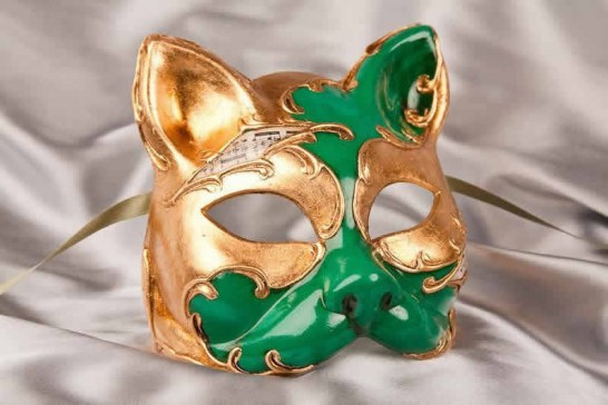 Venetian cat mask with musical notes and gold leaf in green