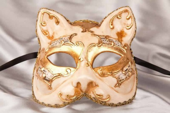 enetian cat mask with musical notes and gold leaf in cream