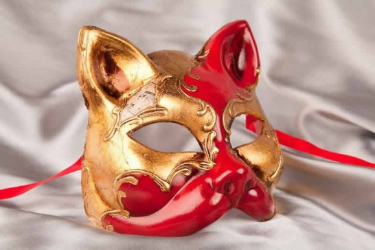 enetian cat mask with musical notes and gold leaf in red