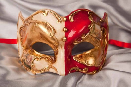red and gold Joker face masquerade mask with Venetian scenes