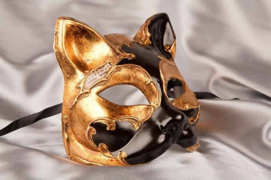 enetian cat mask with musical notes and gold leaf in black