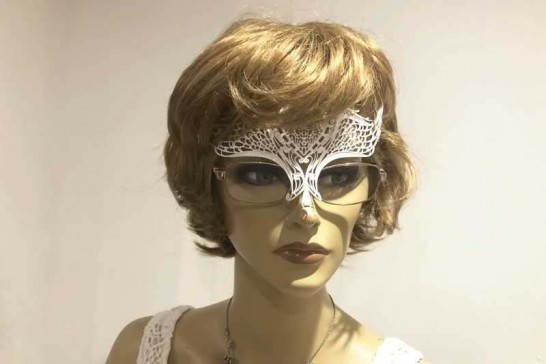 masquerade mask designed to be worn with glasses shown on female model