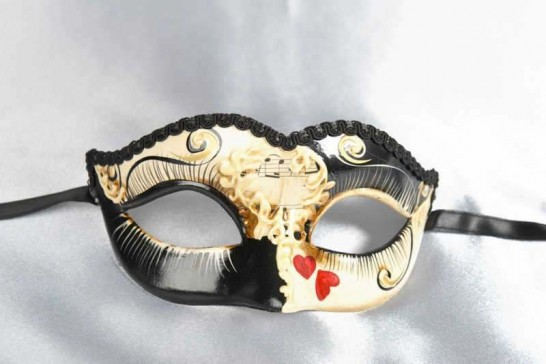 small masquerade mask with heart decoration in black