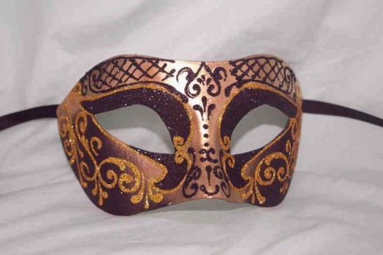 Carnival masquerade mask in gold and black