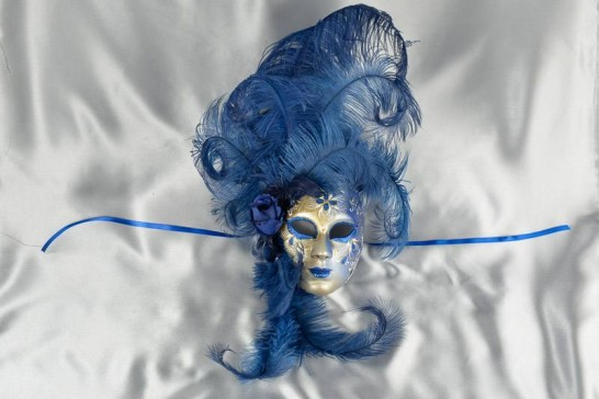 Blue wall mask with feathers