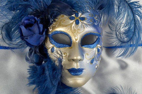 Blue wall mask with feathers close up