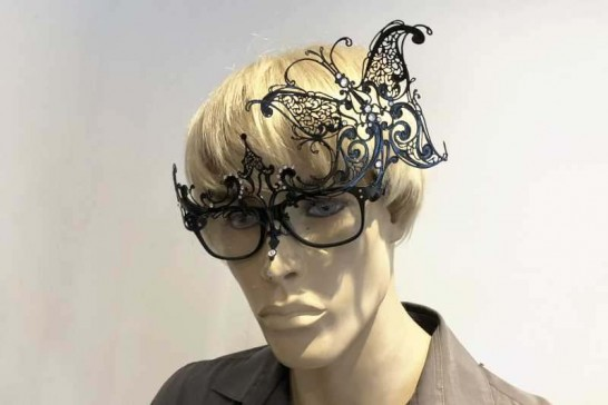 mask attached to glasses on male model - carina