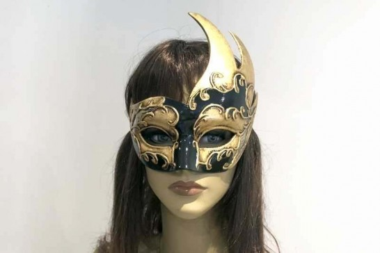 swan shaped animal masquerade mask in black and gold on female face
