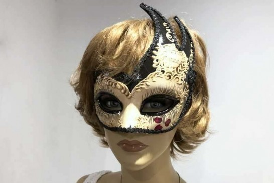 Black love hearts masquerade mask on female model face