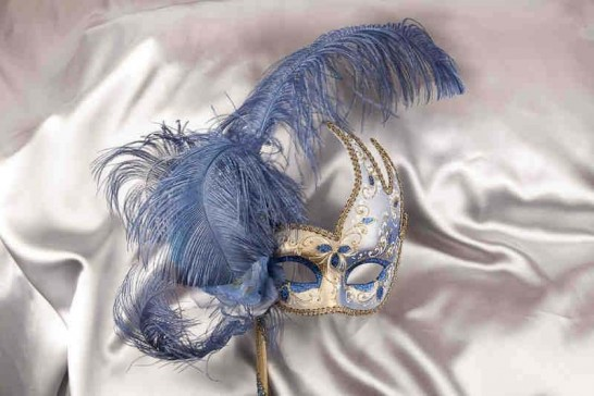 blue and gold feathered mask on stick