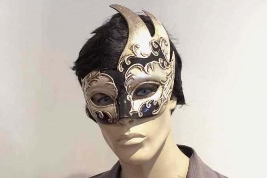 swan shaped animal masquerade mask in black and silver on male face