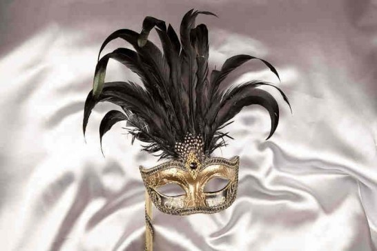 black and gold feathered mask on stick for women