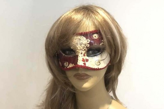 Colombina masquerade mask with heart decoration on female face
