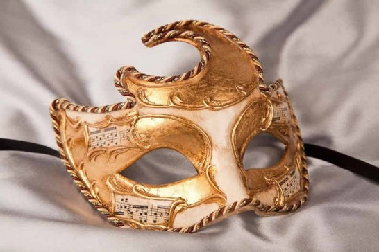 Moon shaped masquerade mask in gold and cream