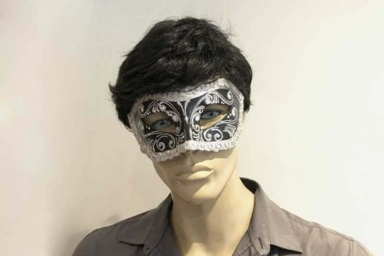 Silver Colombina masquerade mask with glitter and braiding on male face