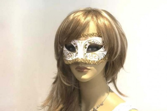 white and gold Venetian ball mask on female face