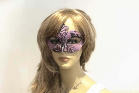 Black and Pink small carnival masquerade mask on female face