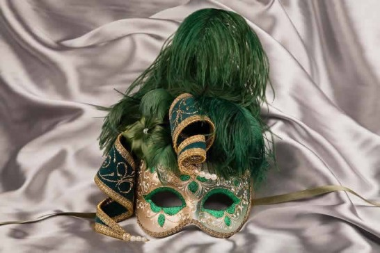 Green and gold trim Venetian jolly mask with feathers and jester bells