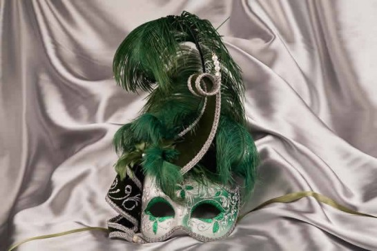 Green and silver trim Venetian jolly mask with feathers and jester bells