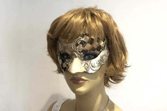 Carnvial masquerade mask with black and white diamond checks on female face