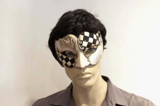 Carnvial masquerade mask with black and white diamond checks on male face