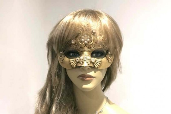 Gold Madam Macrame masquerade mask on female face