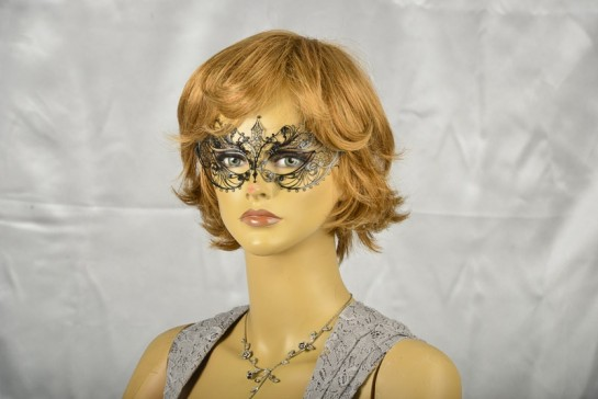 laser cut masquerade mask on female face