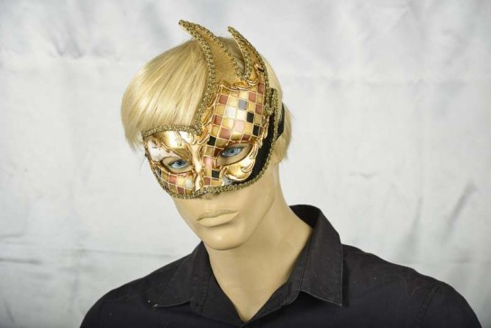 black and gold mosaic swan masquerade mask on male face