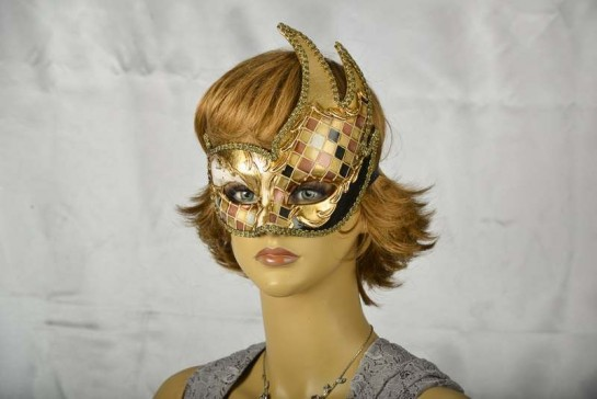 black and gold mosaic swan masquerade mask on female face