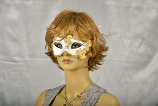 white and gold lace masquerade mask on model