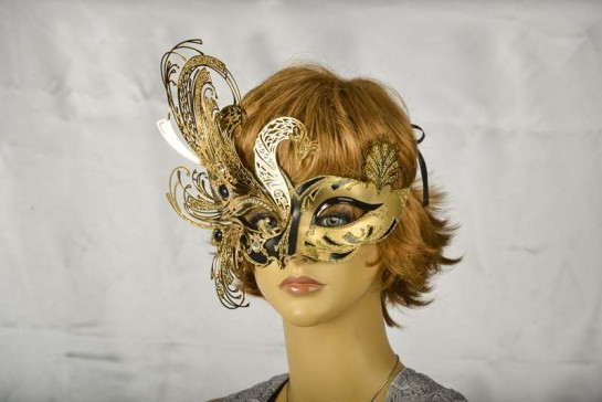 Exquisite Venetian mask in black and gold on model face