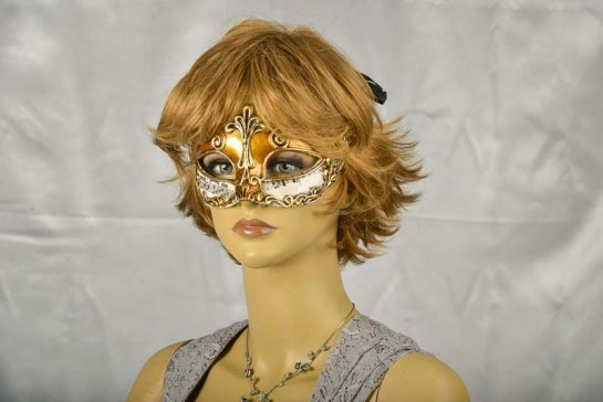 Gold Madam music masquerade mask on female model face