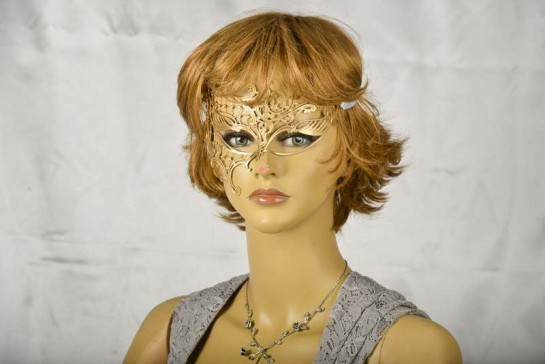 Gold filigree metal mask on model