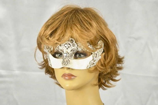 silver macrame lace covered Venetian masquerade mask on female model face