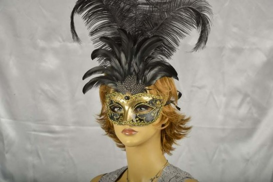 Luxury tall feather masquerade mask on female model face