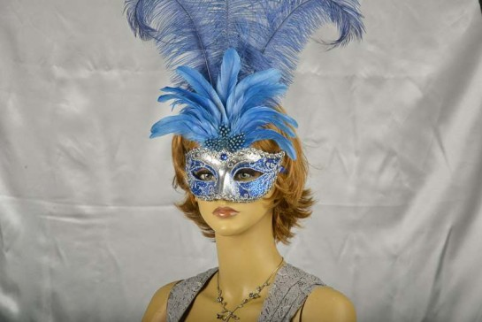 Luxury tall feather masquerade mask on female face