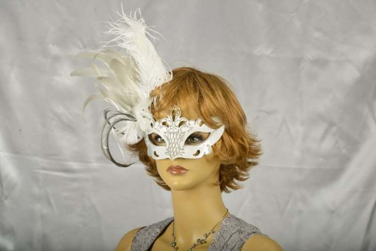 Luxury side feather Venetian masquerade mask on face of female