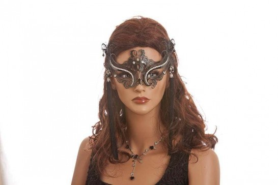 black lace mask with earrings on female face