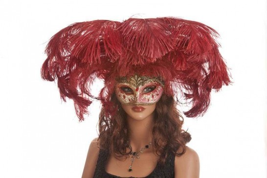 Large feather carnival mask shown on model face