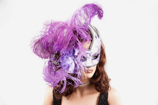 Luxury feathered mask for women shown on female model face