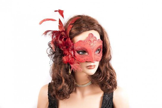 side feather masquerade mask on womans face