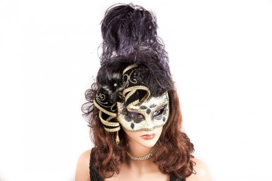 Gold trim Venetian jolly mask with feathers and jester bells on female face