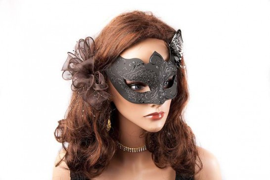 black butterfly masked ball mask on female face