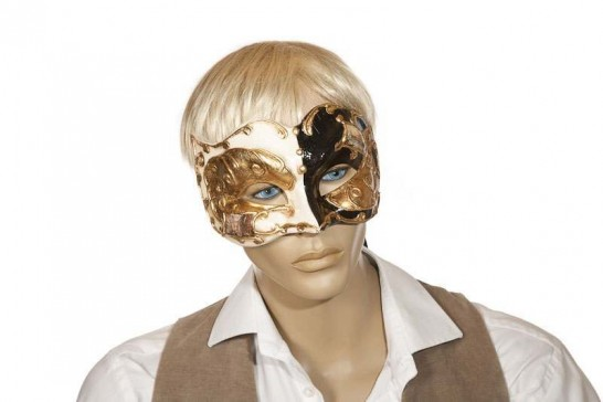 black and gold Joker face masquerade mask with Venetian scenes modeled on a face