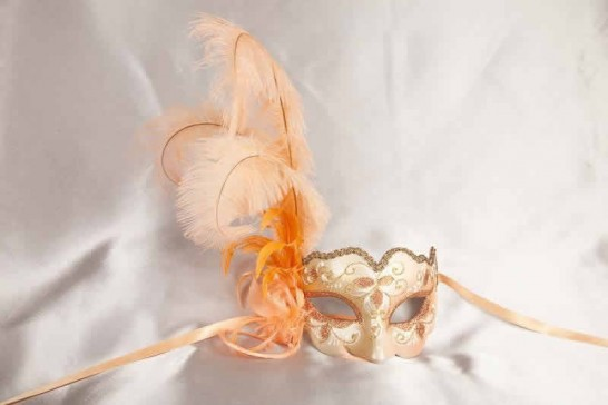 peach and gold feathered mask