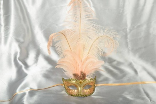tall feather ladies masquerade mask in peach and gold